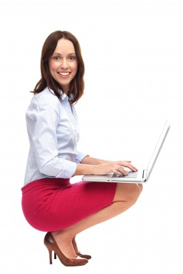 Woman wearing red skirt, working on computer